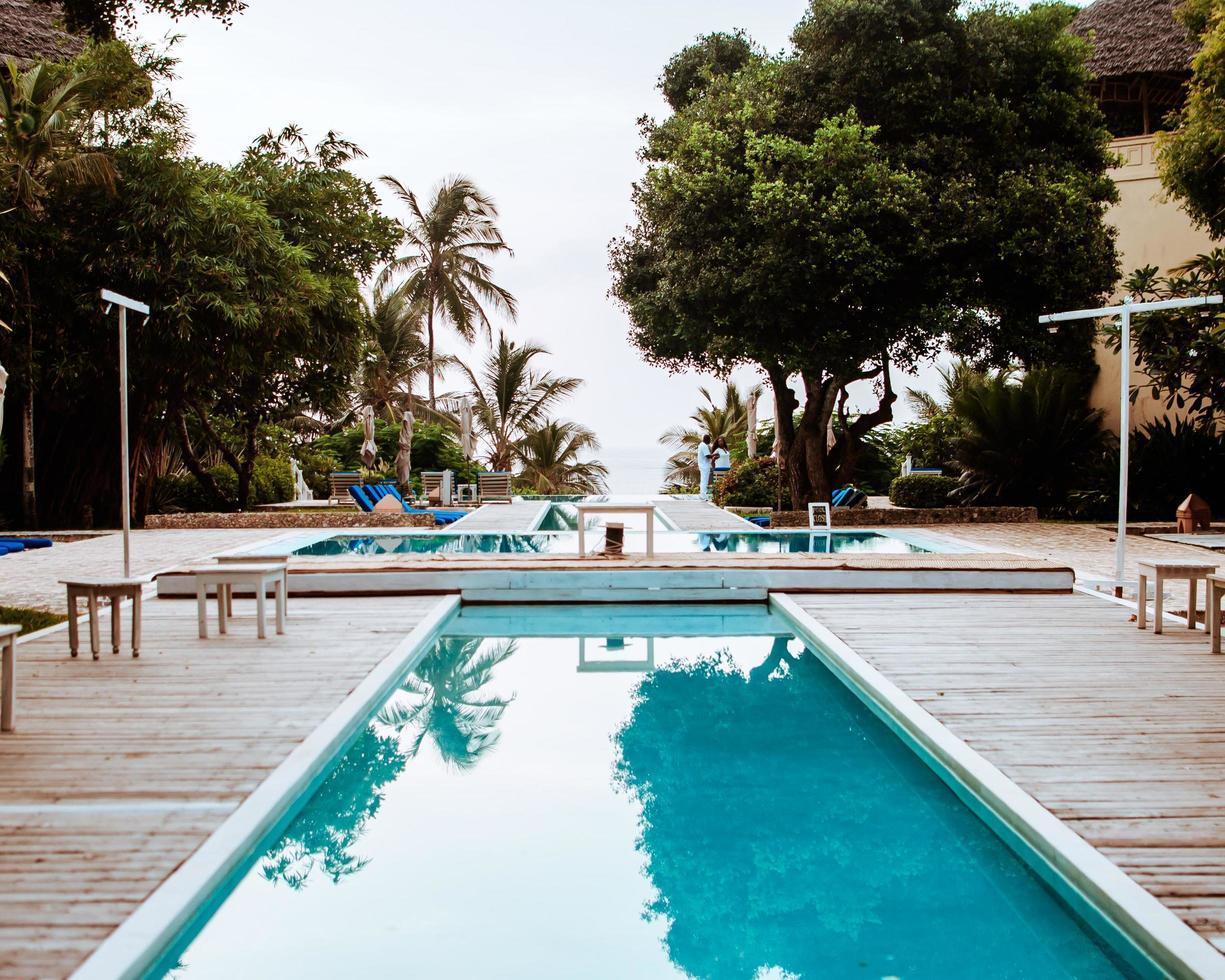 Two people at resort swimming pool photo
