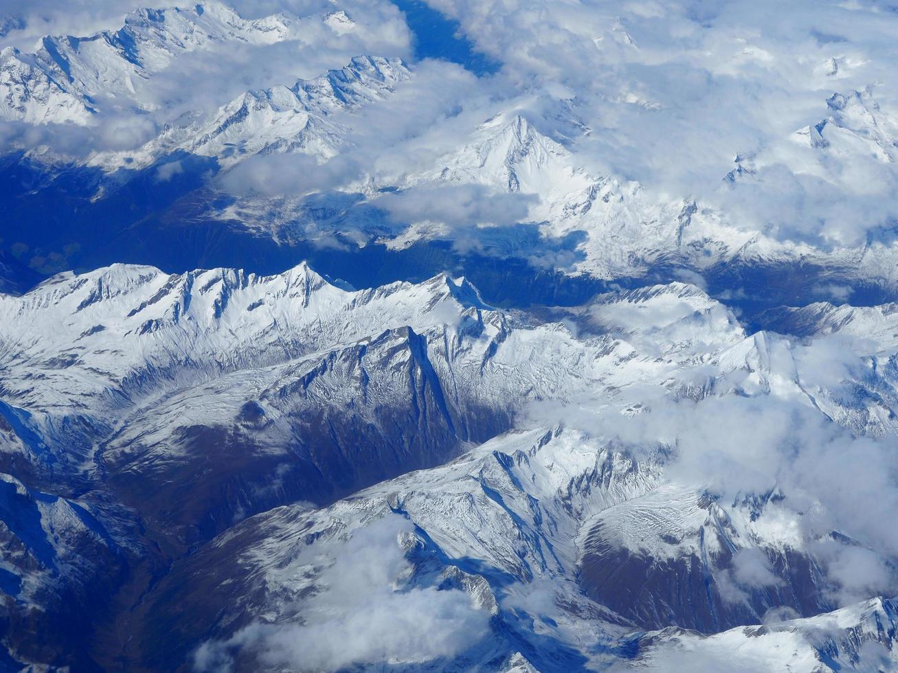 Aerial view of snowcapped mountains photo