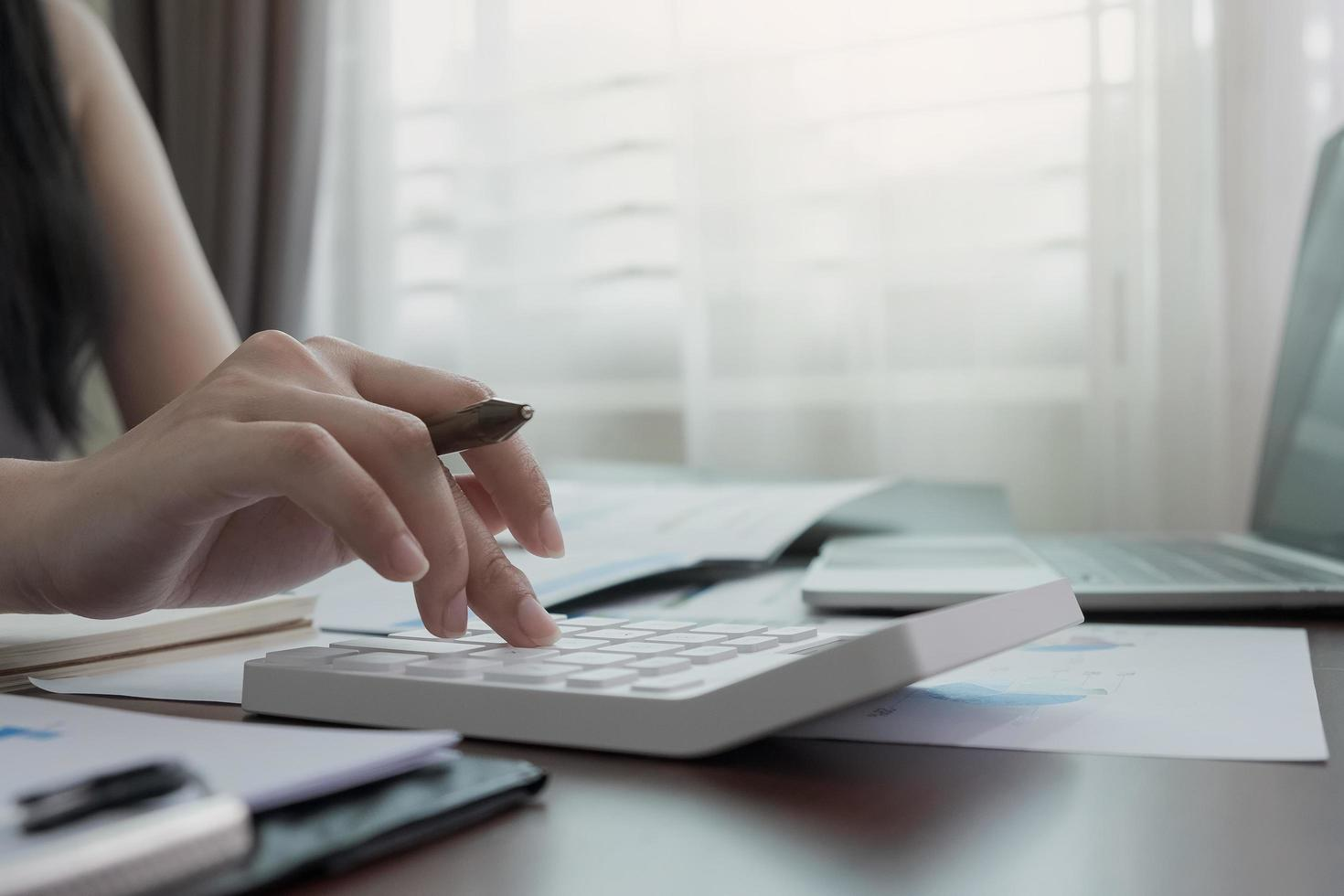 Close-up of woman working from home photo