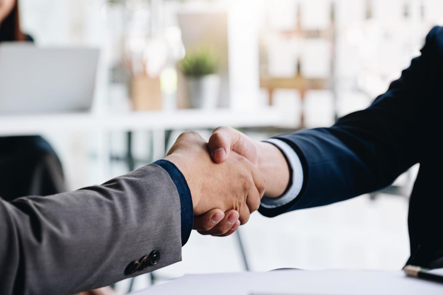 Close-up of a handshake between two professionals photo