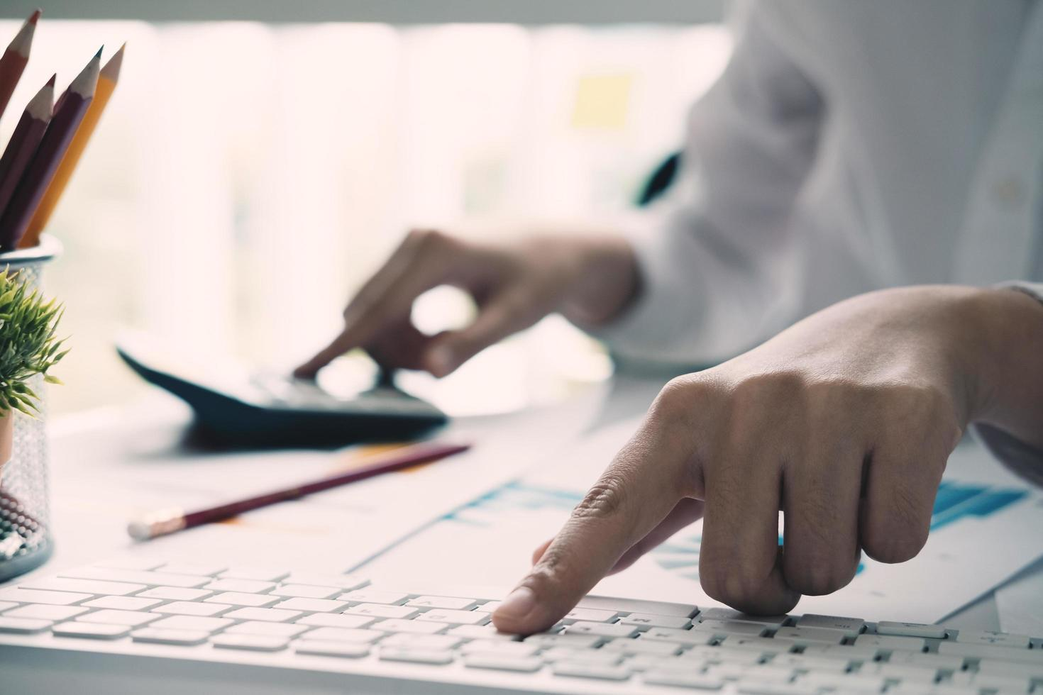 Close-up of bookkeeper calculating or checking balance photo