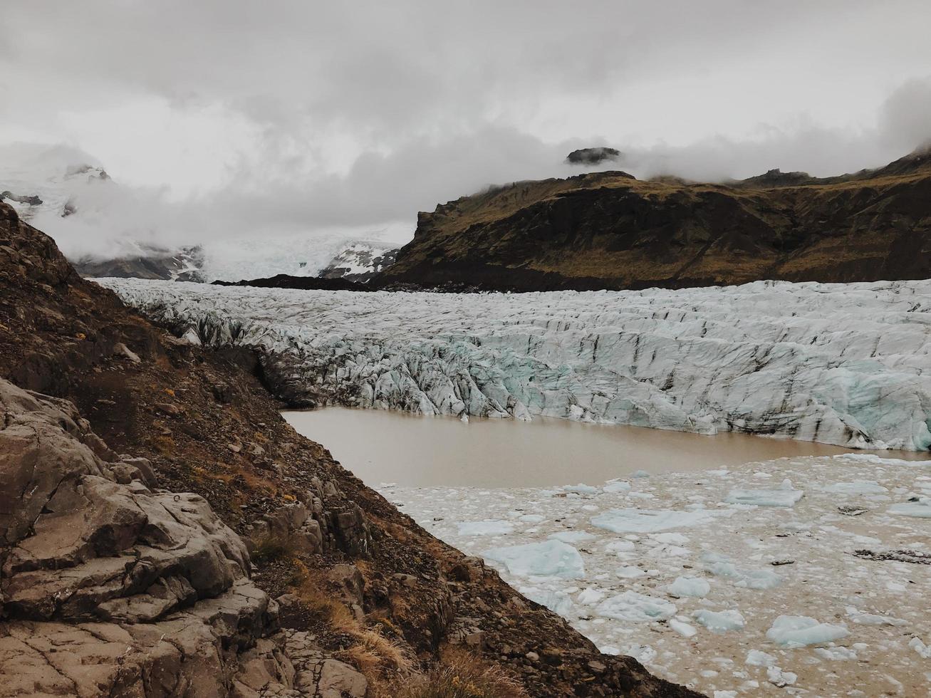 Glacier between rocky cliffs photo