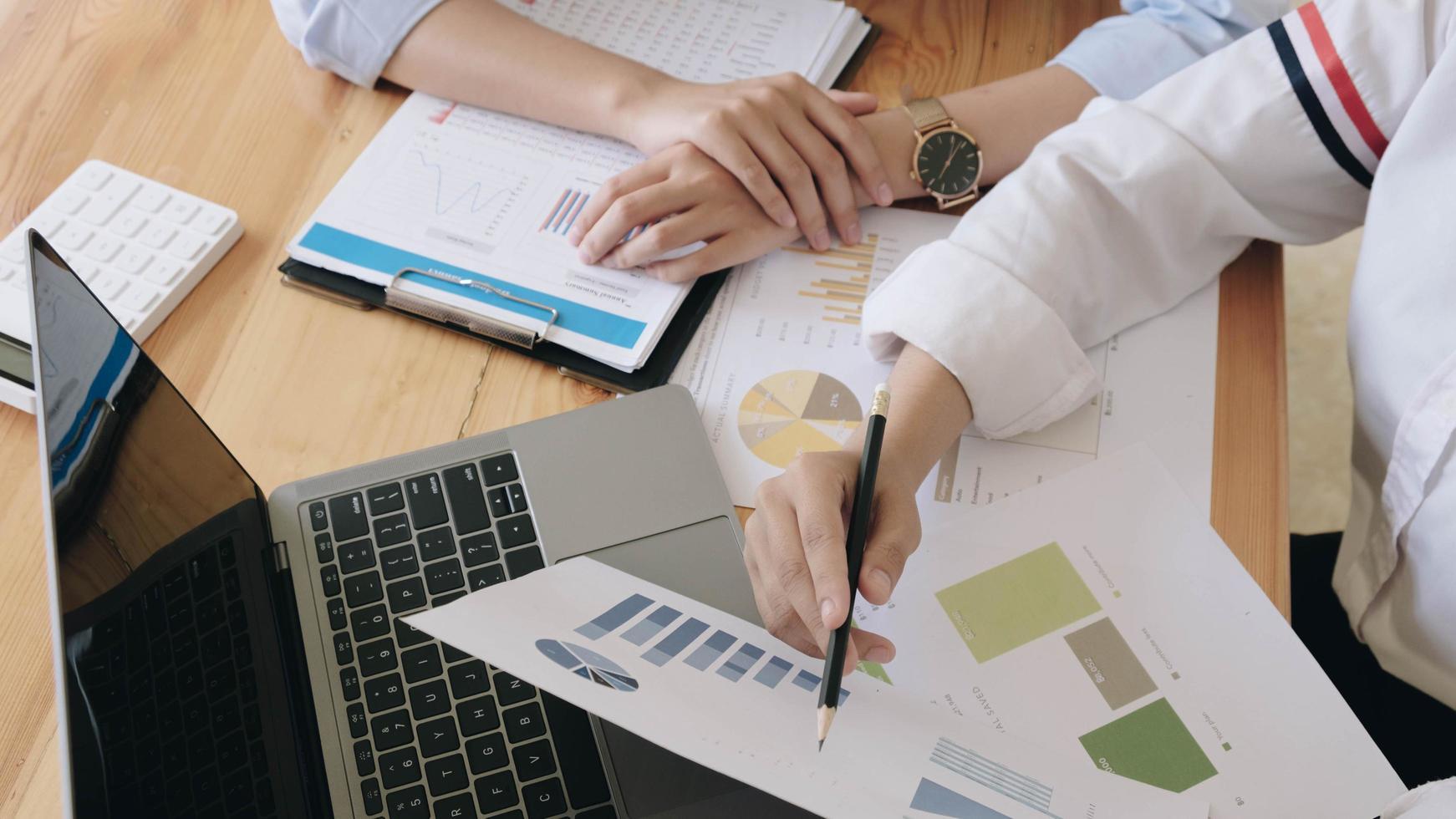 Two businesswomen analyzing financial report photo