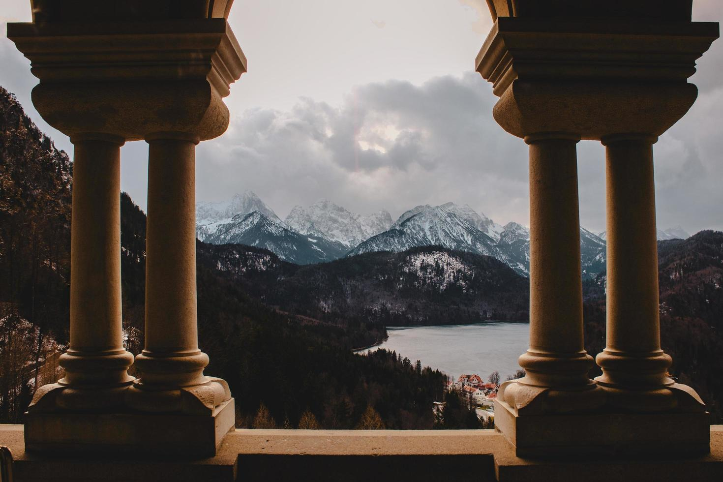 Mountain range framed by columns photo