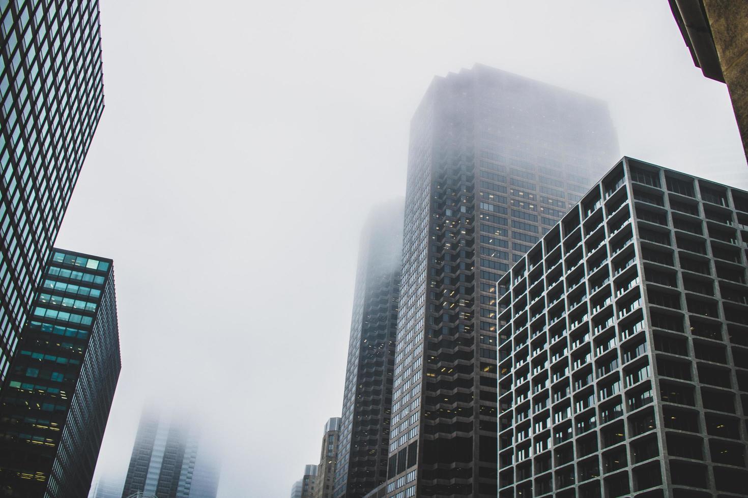 Foggy skyscraper buildings from below photo