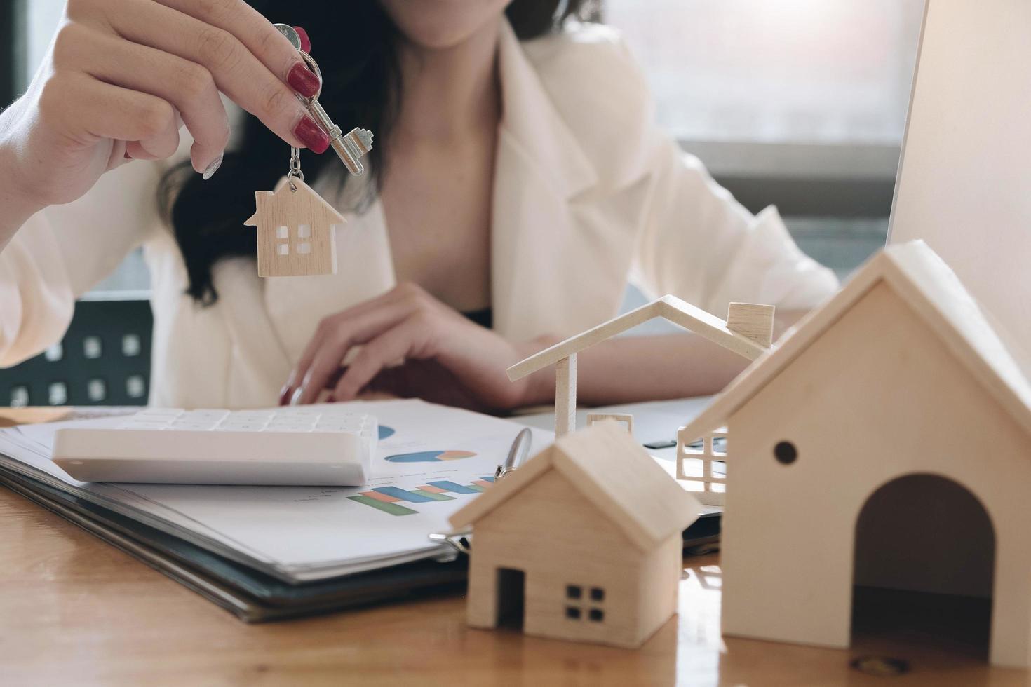 Real estate agent holding house keys photo