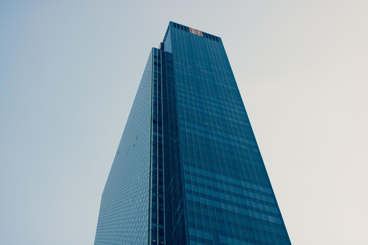 Skyscraper building under cloudy sky photo