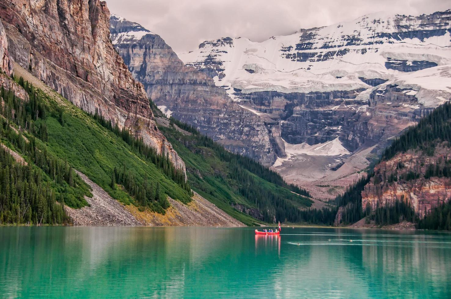 Red boat In lake in Banff National Park photo
