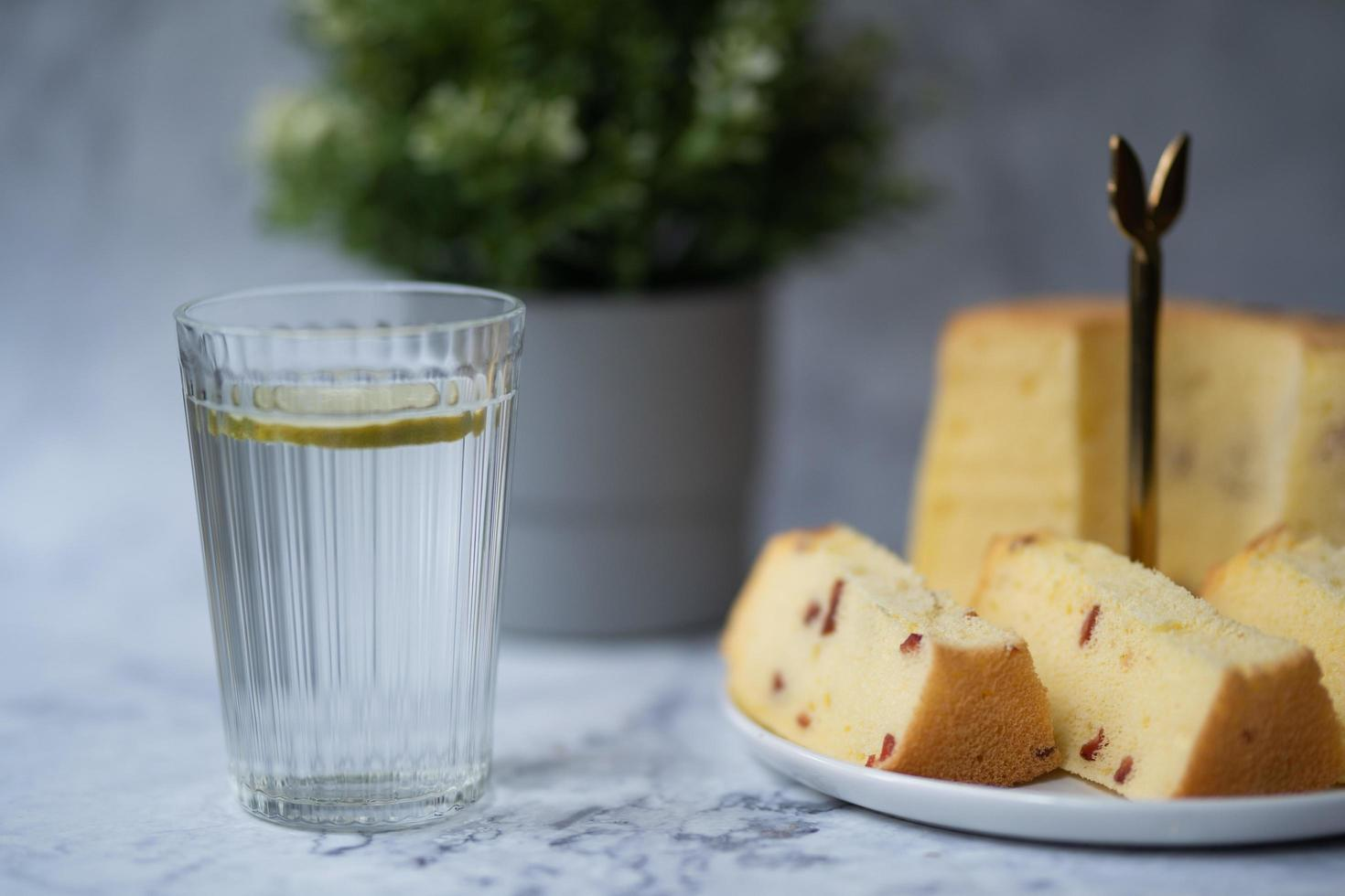 Glass of water with cake photo