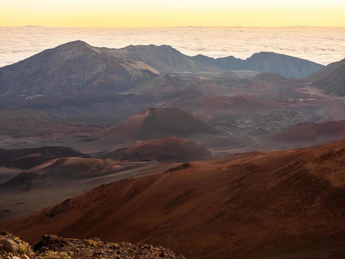 Brown and gray mountains at sunset photo