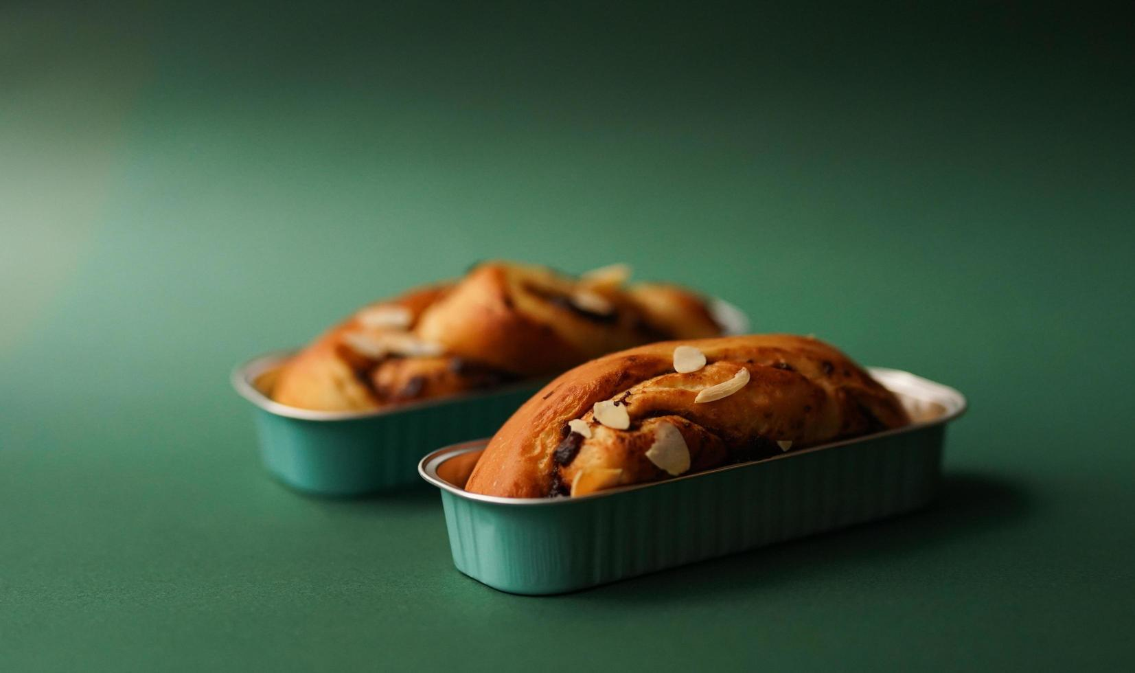 Two banana cakes on green background photo