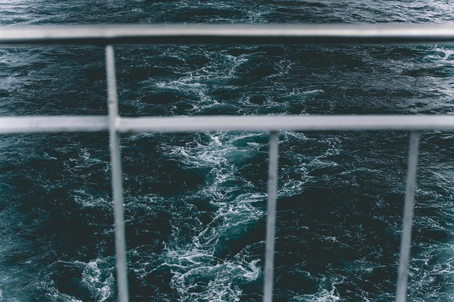 Boat railing, view through, over water photo