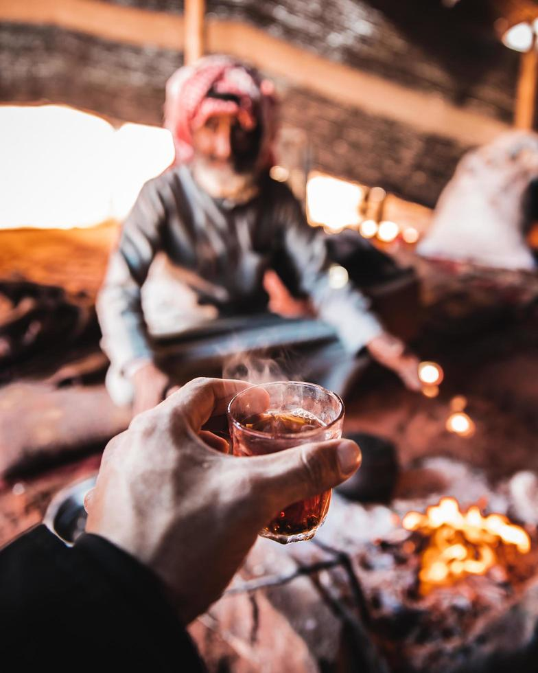 First-person point of view drinking tea in Middle-Eastern tent photo