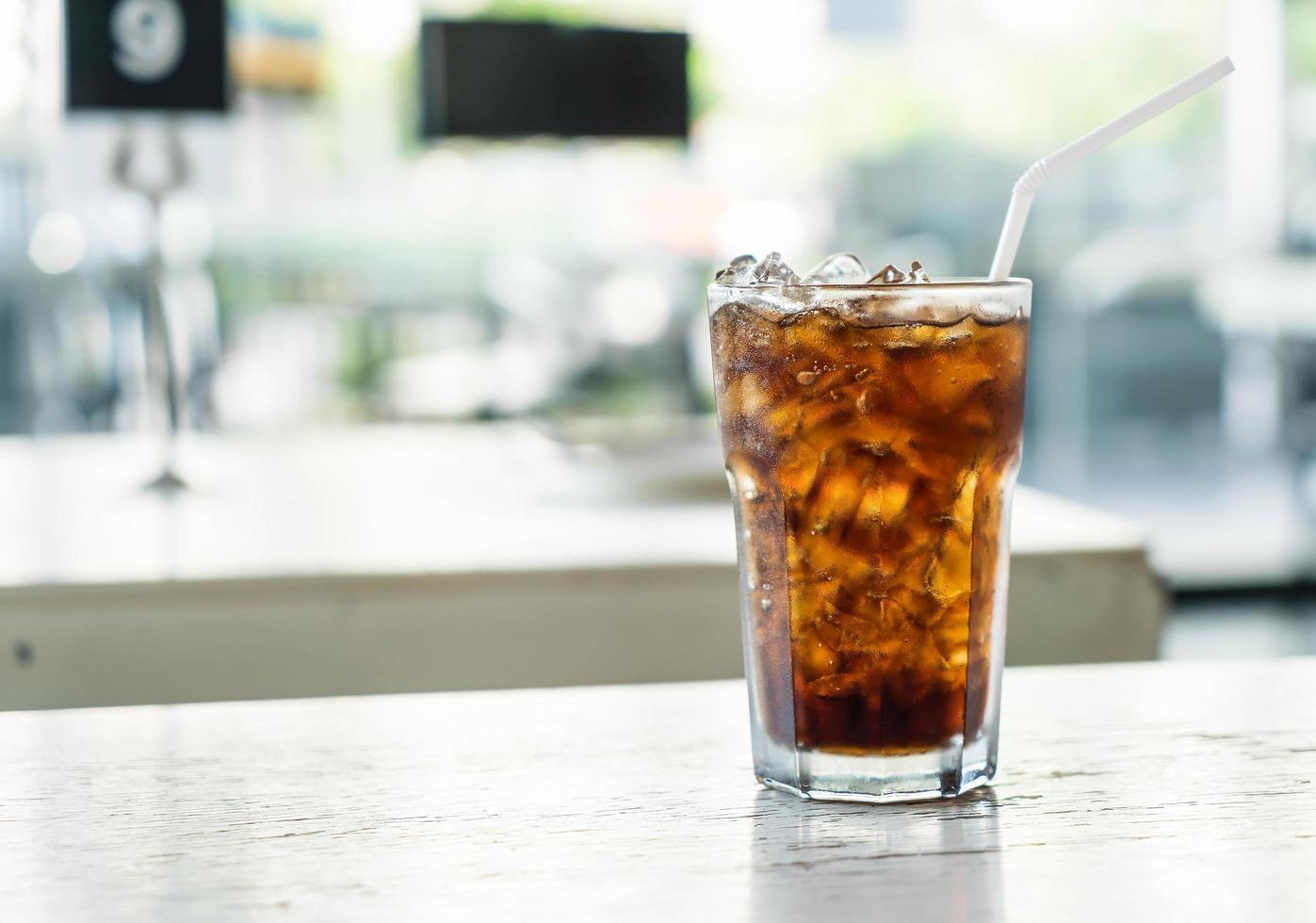 Iced soda on table photo