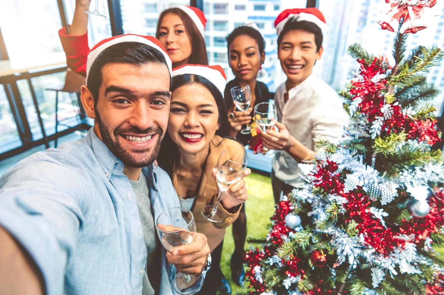 A multiethnic group of people at a holiday party photo