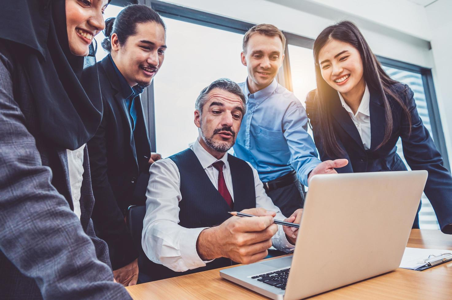 Group of business people working on laptop photo