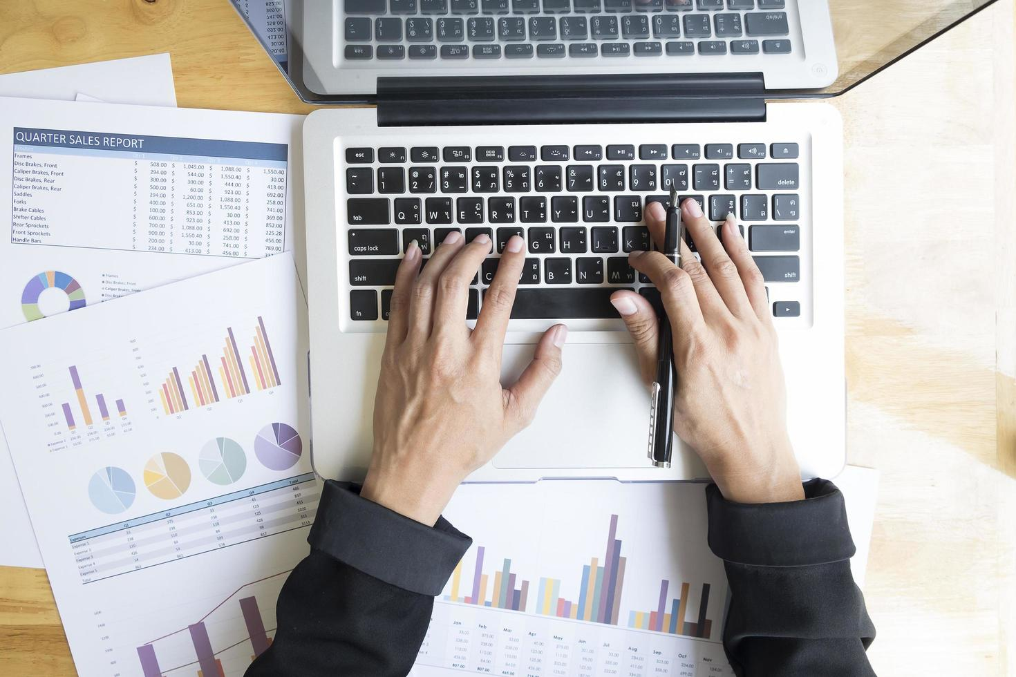 Table top view of businessperson using a laptop at work photo