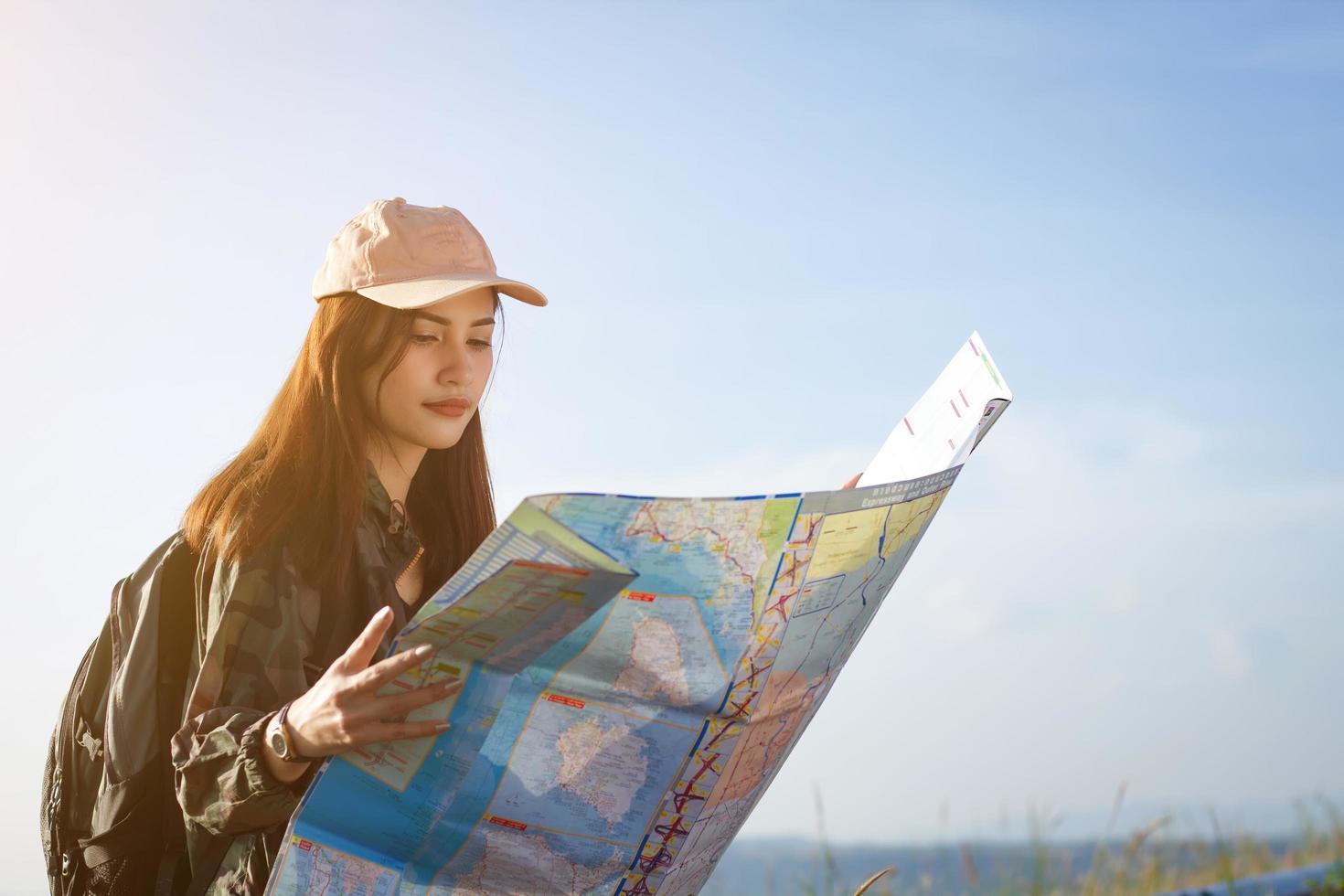 Woman hiker looking at map photo