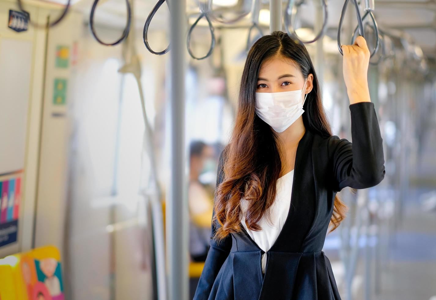Young female taking sky train to work  photo