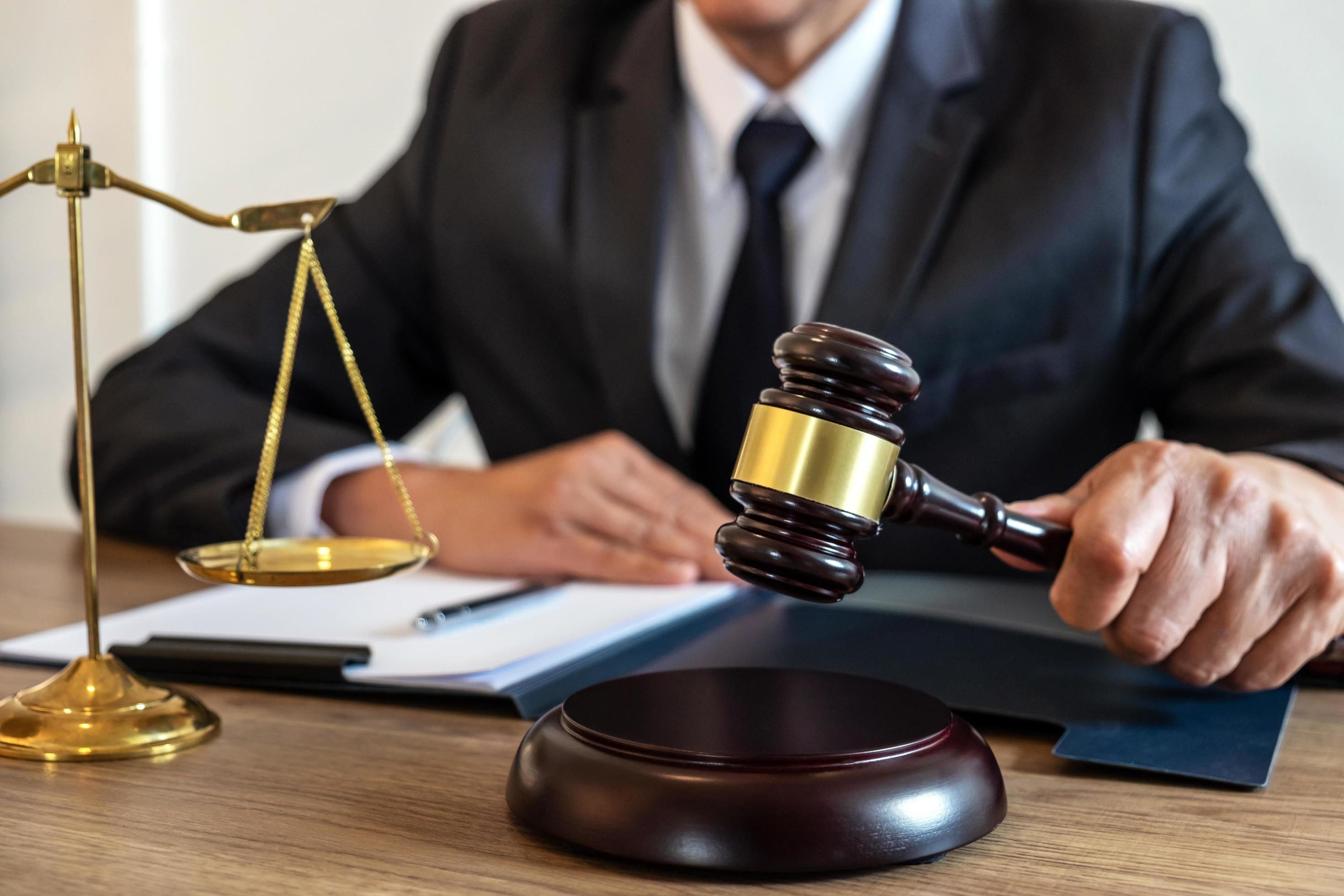 Judge banging gavel on table Stock Photo