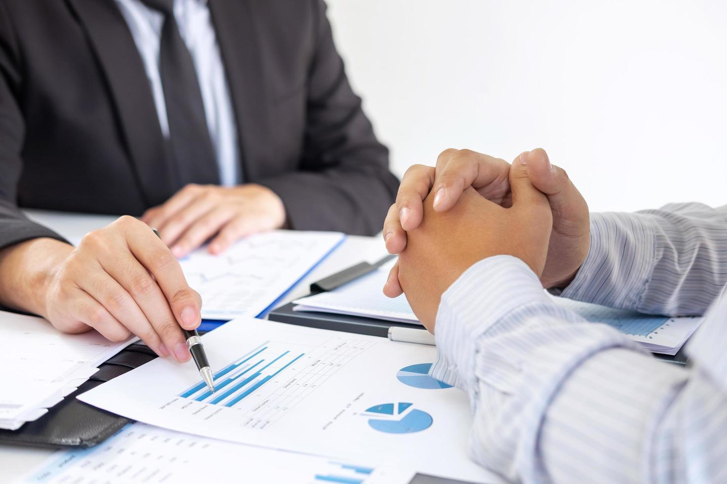 Two people discuss business plan photo