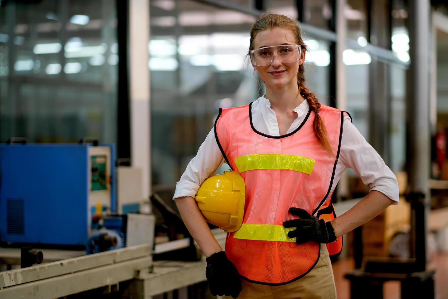 Young female engineer stands at work on rest break  photo