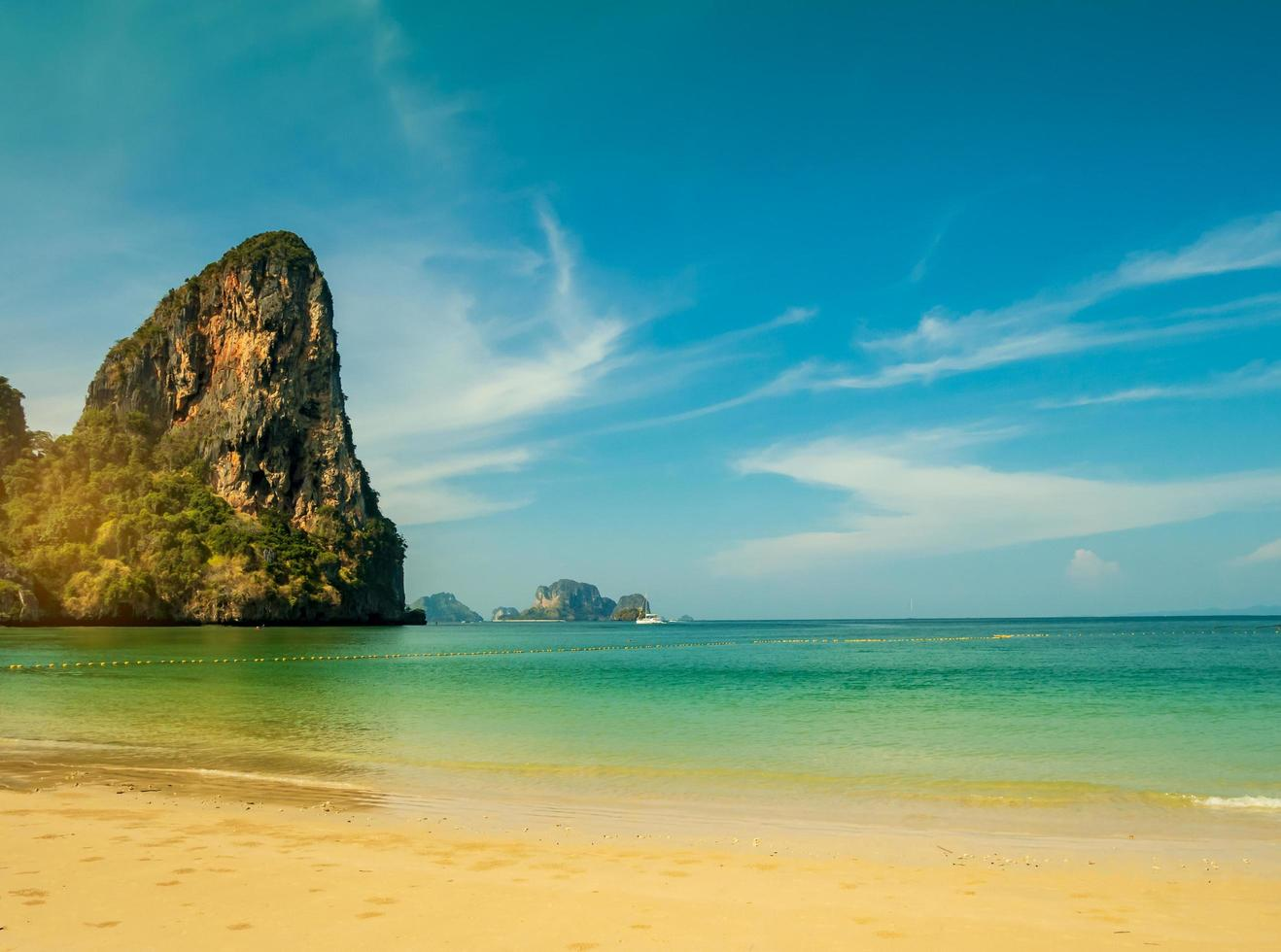 Tropical beach and limestone mountains photo