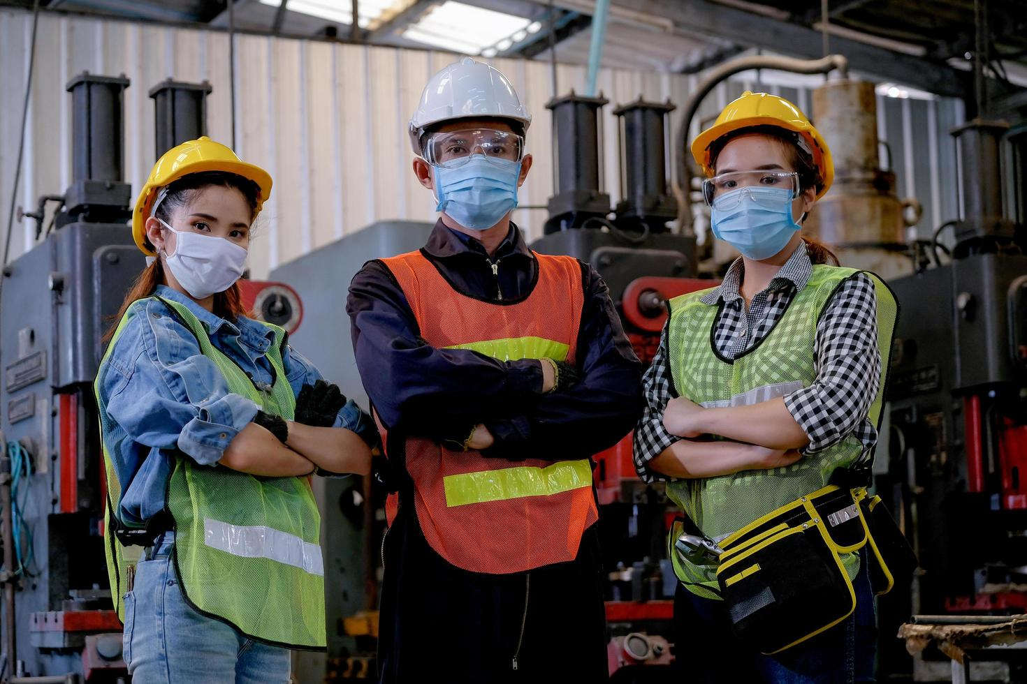Group of technicians standing together at work photo