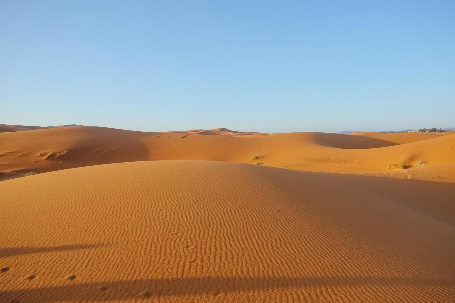 Erg Chebbi sand dune against clear blue sky photo