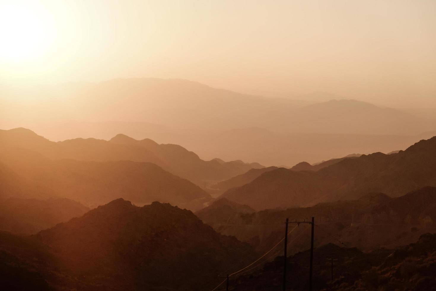 Sunset over layers of mountain range photo