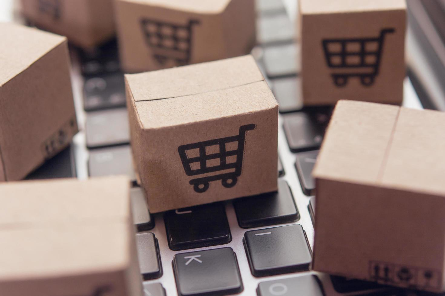 Miniature shipping boxes on keaybord photo