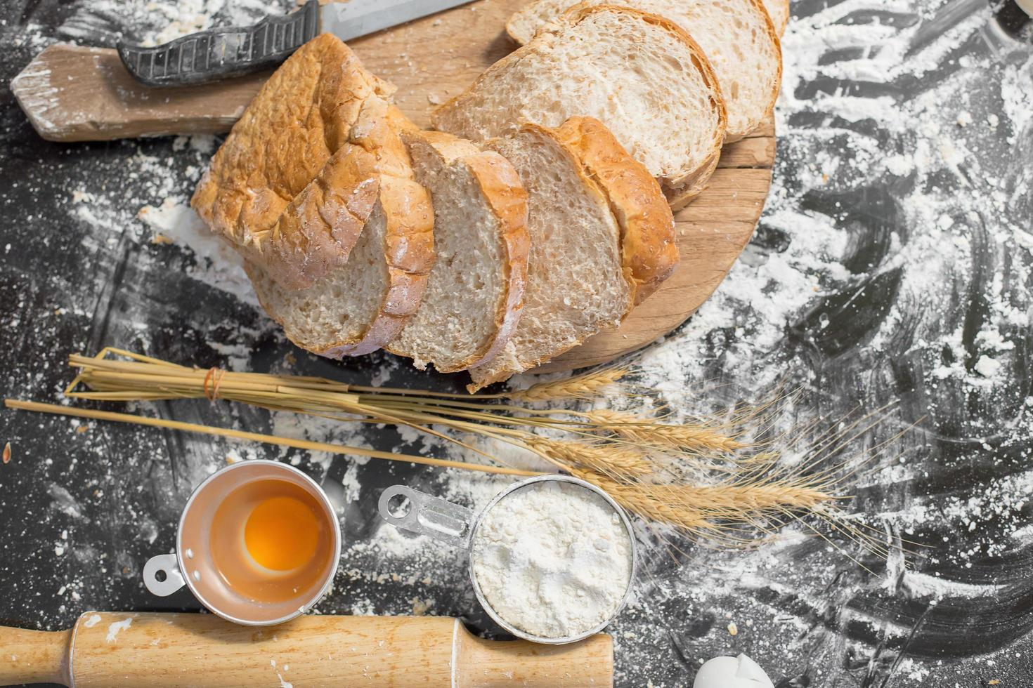 Rustic style bread on a wooden table photo