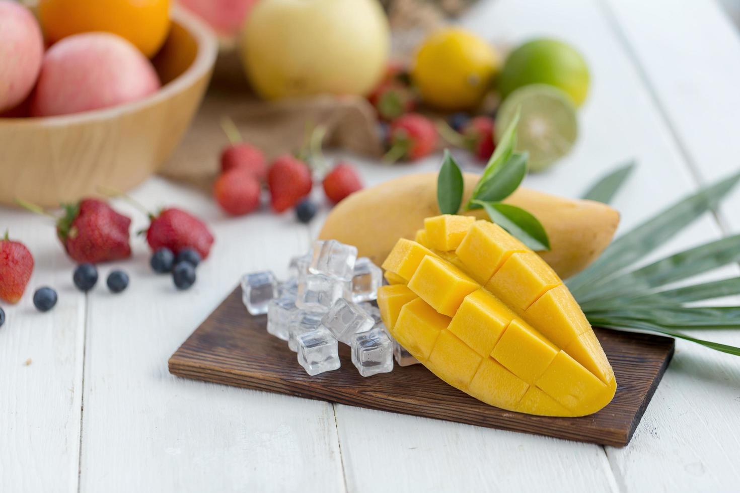 Sliced mango and other fruit photo