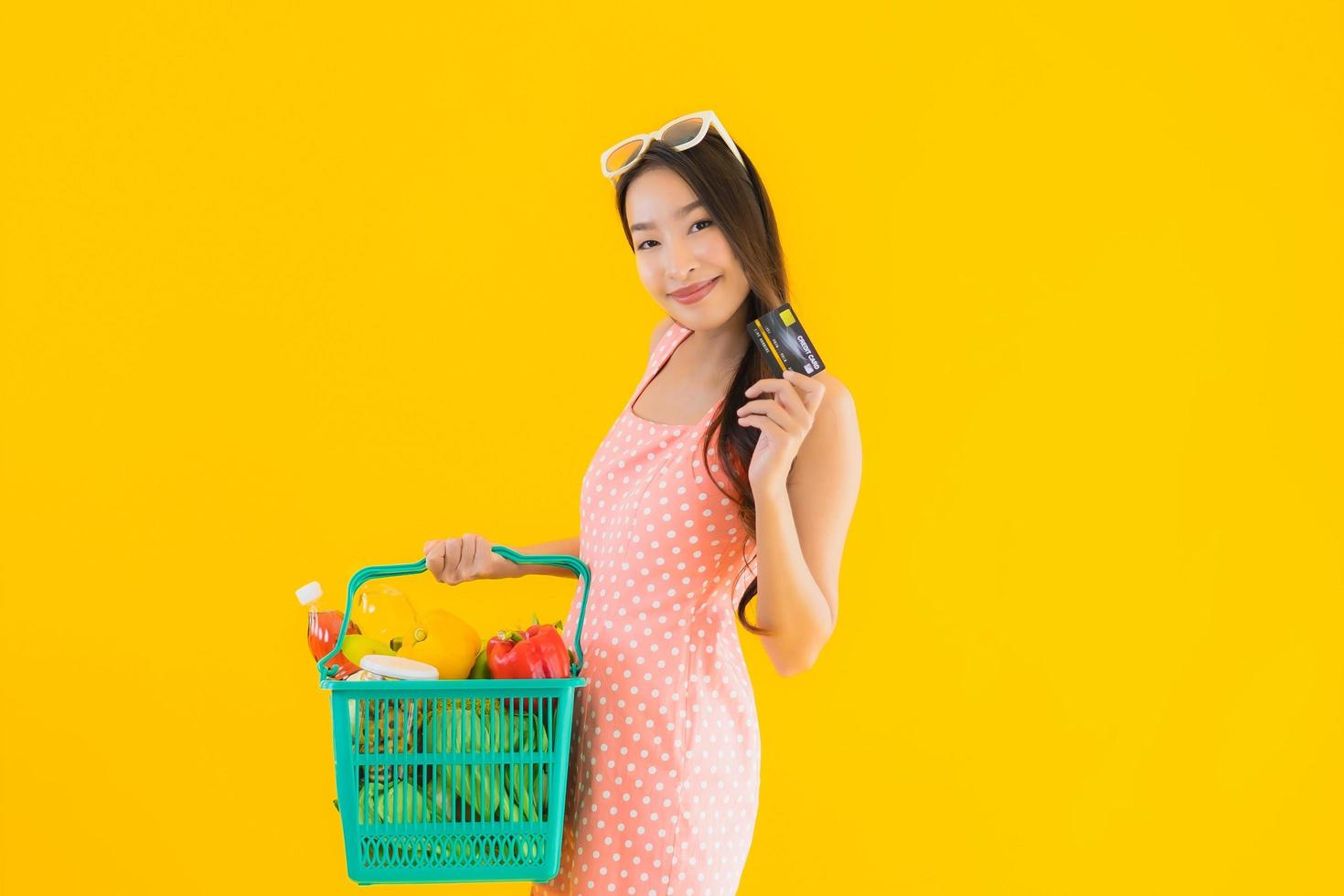 Portrait of woman with grocery basket photo
