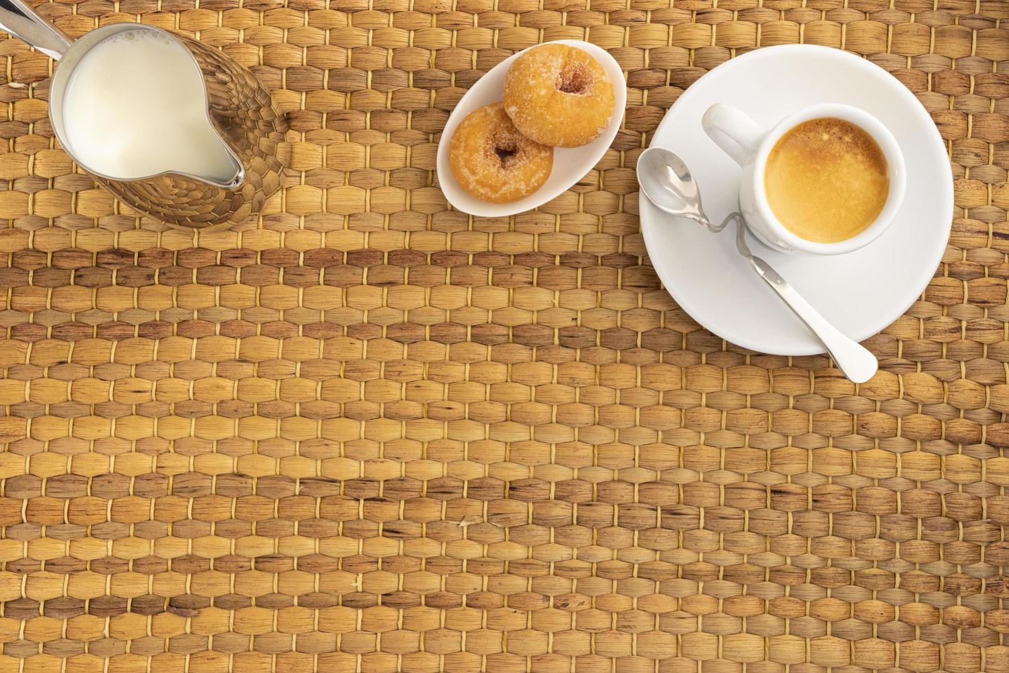 Coffee donuts and creamer flat lay  photo
