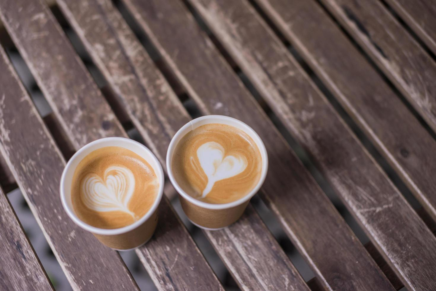 Two lattes on wooden table photo