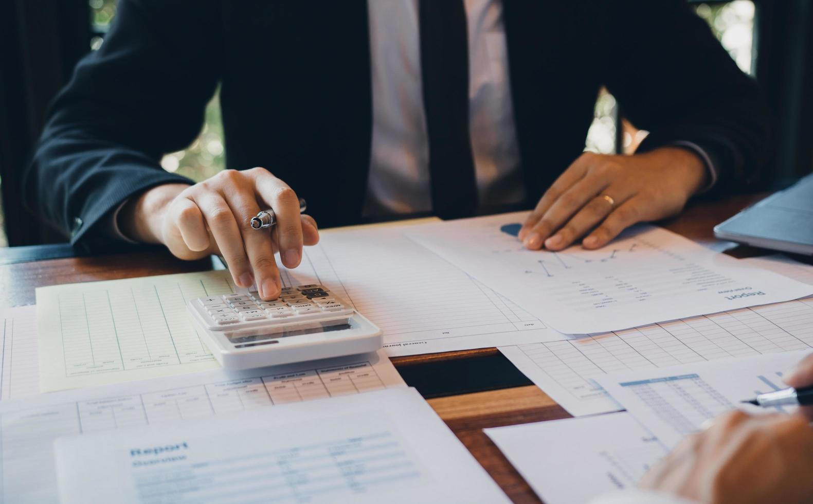 Businessman calculating cost of company's sales  photo