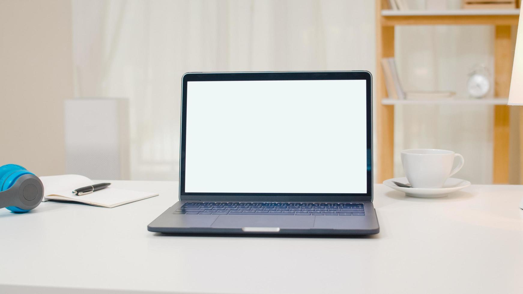 Open laptop computer with blank screen at home photo