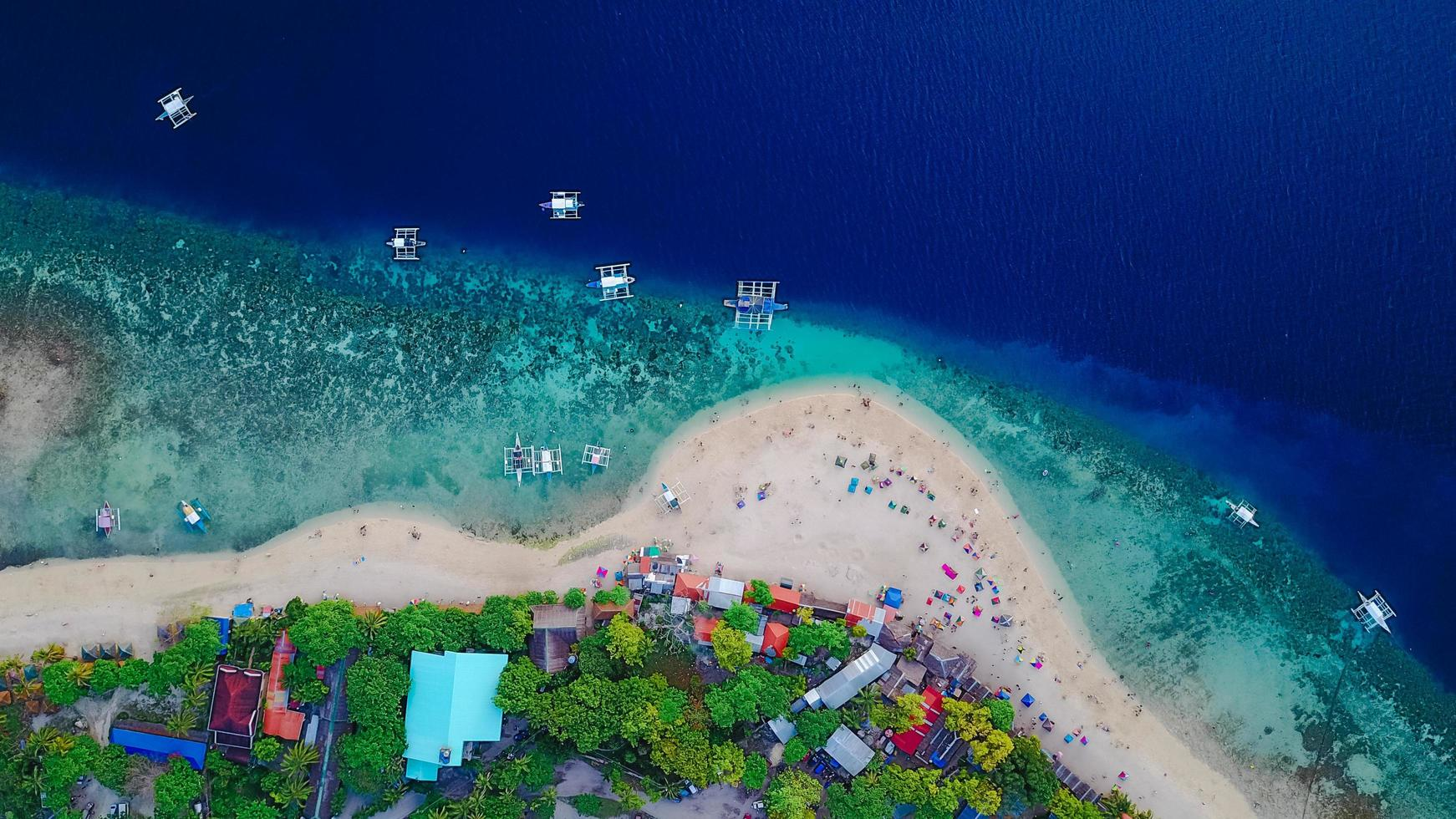 Aerial view of sandy Philippines beach with tourists  photo