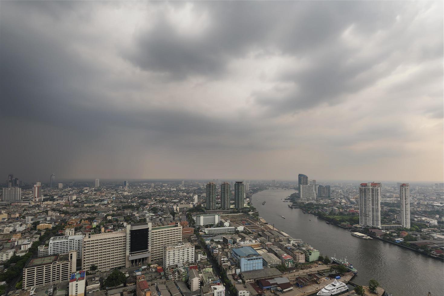 Bangkok city scape under cloudy skies photo