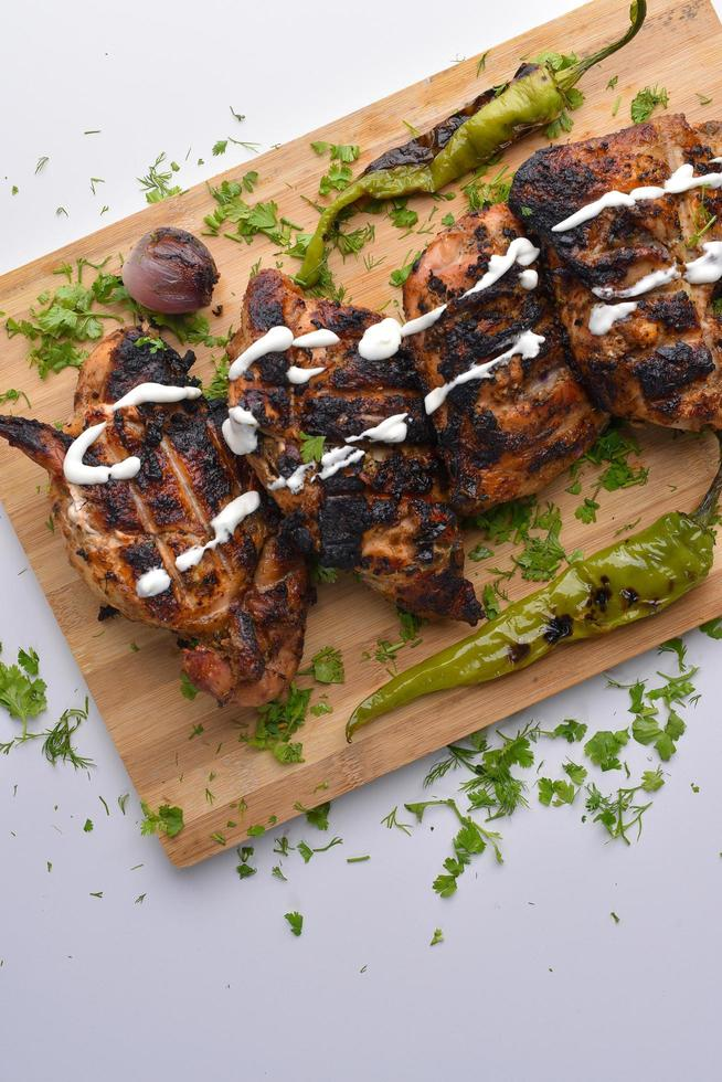 Grilled chicken on cutting board photo