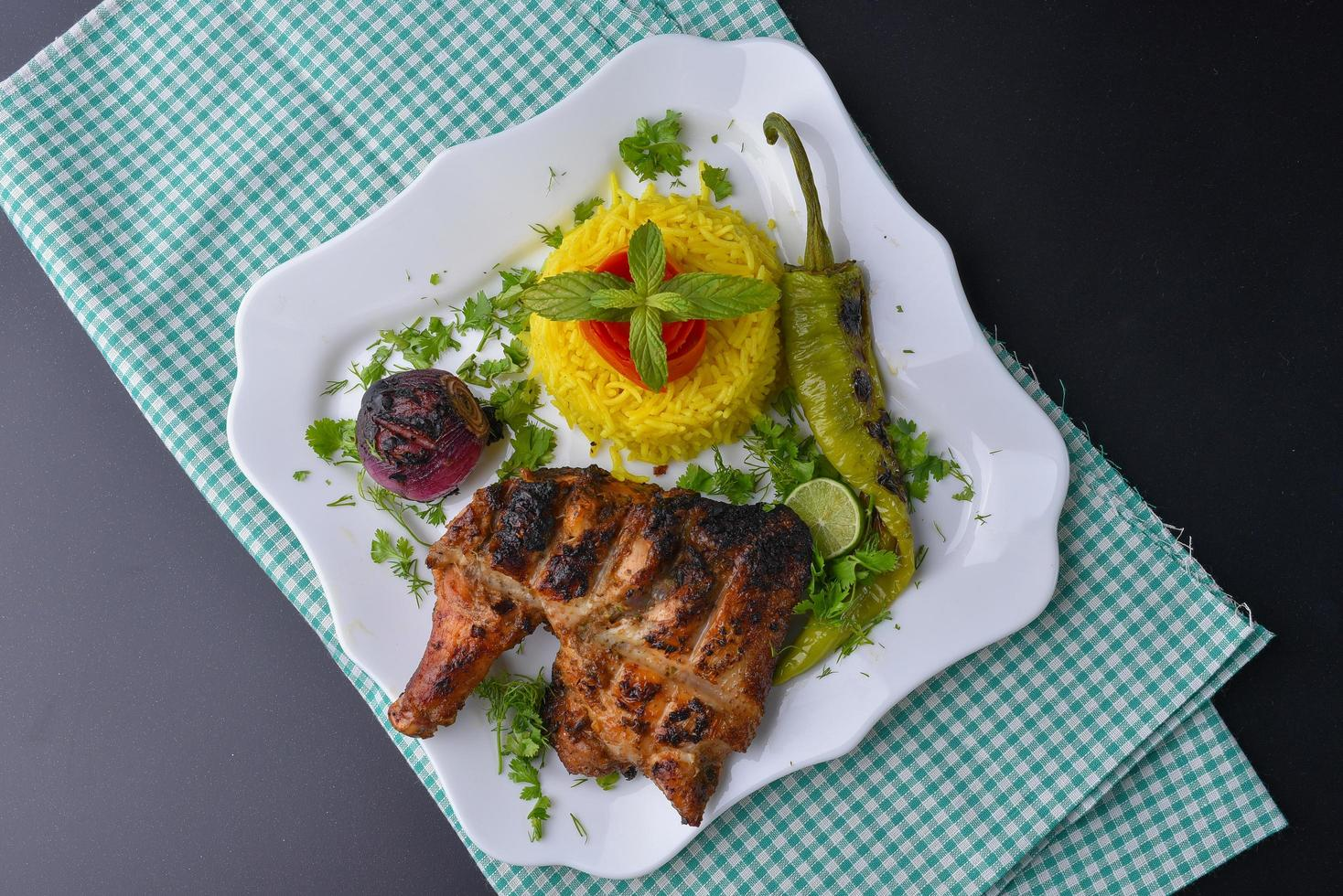 Plate of grilled chicken with sides photo