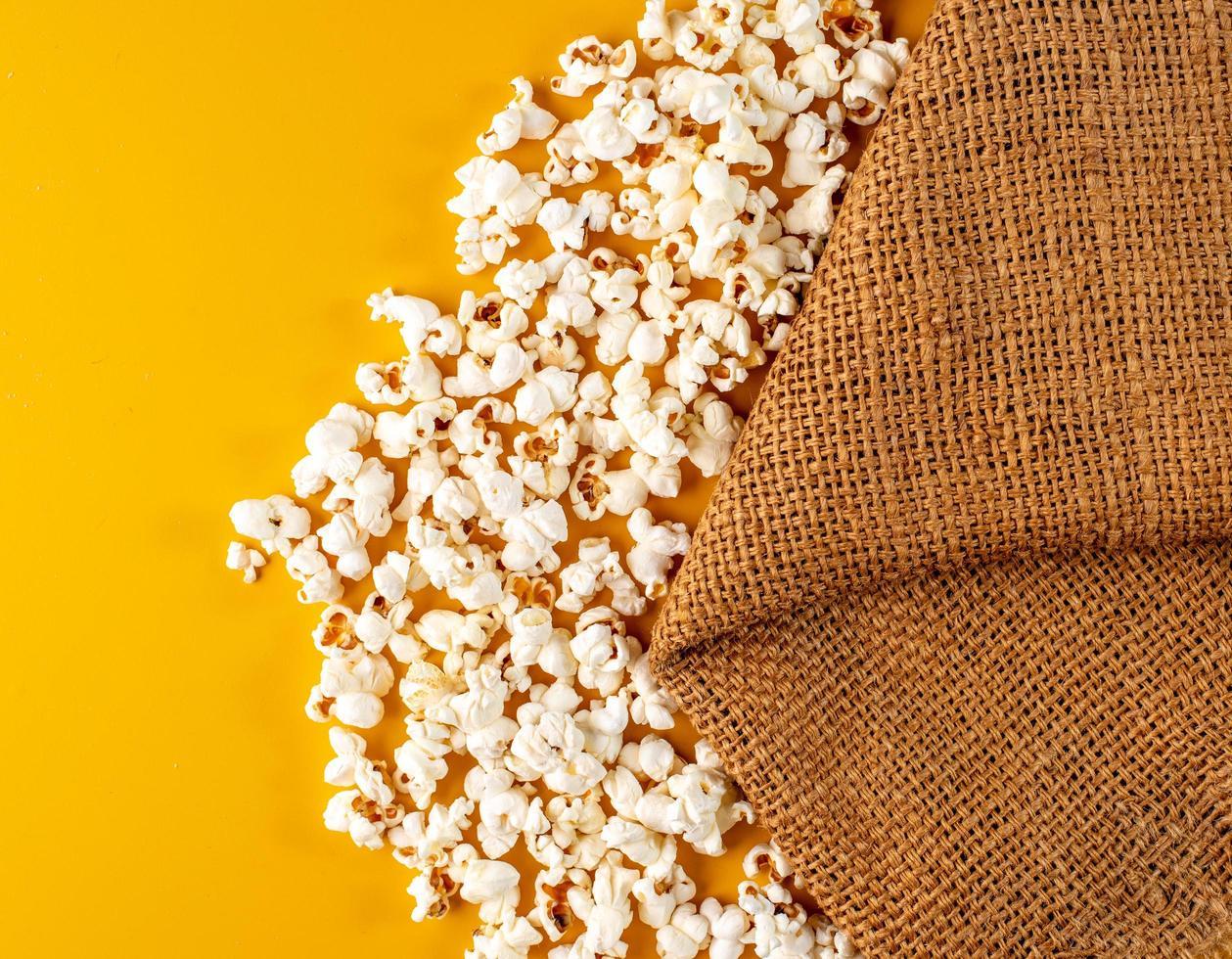 Popcorn on yellow background photo