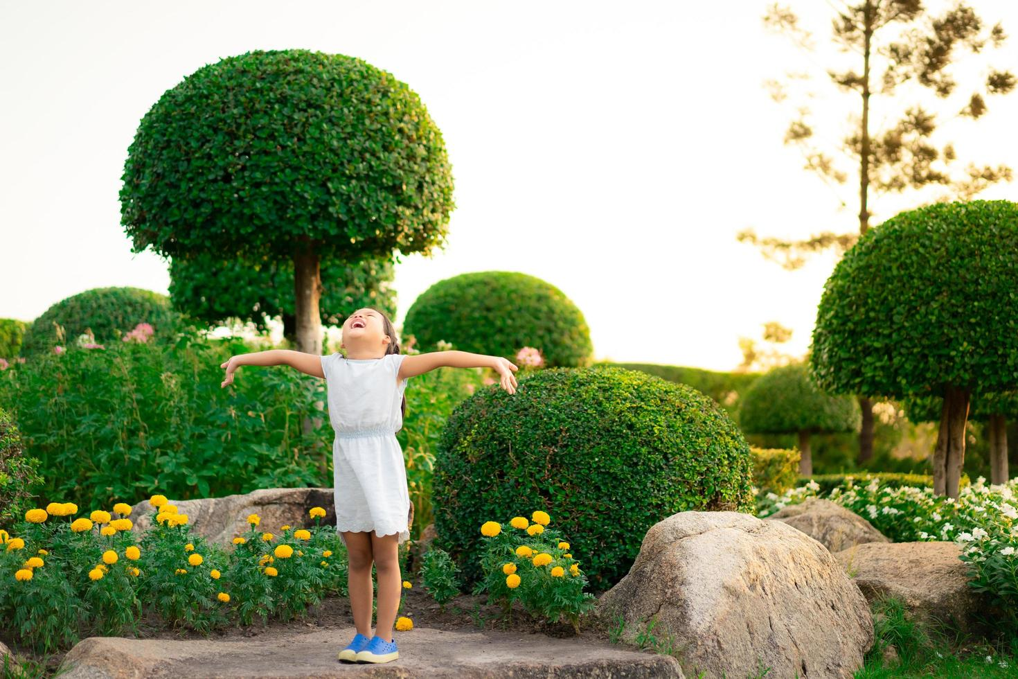 Young Asian girl with outstretched arms photo
