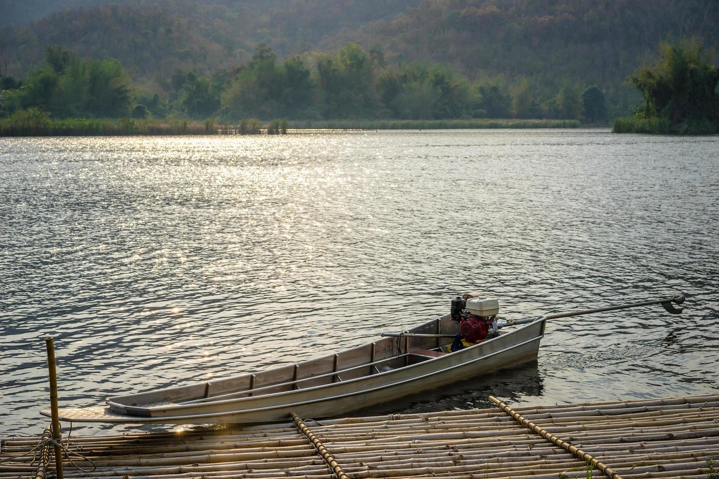 Boat at dock on lake photo