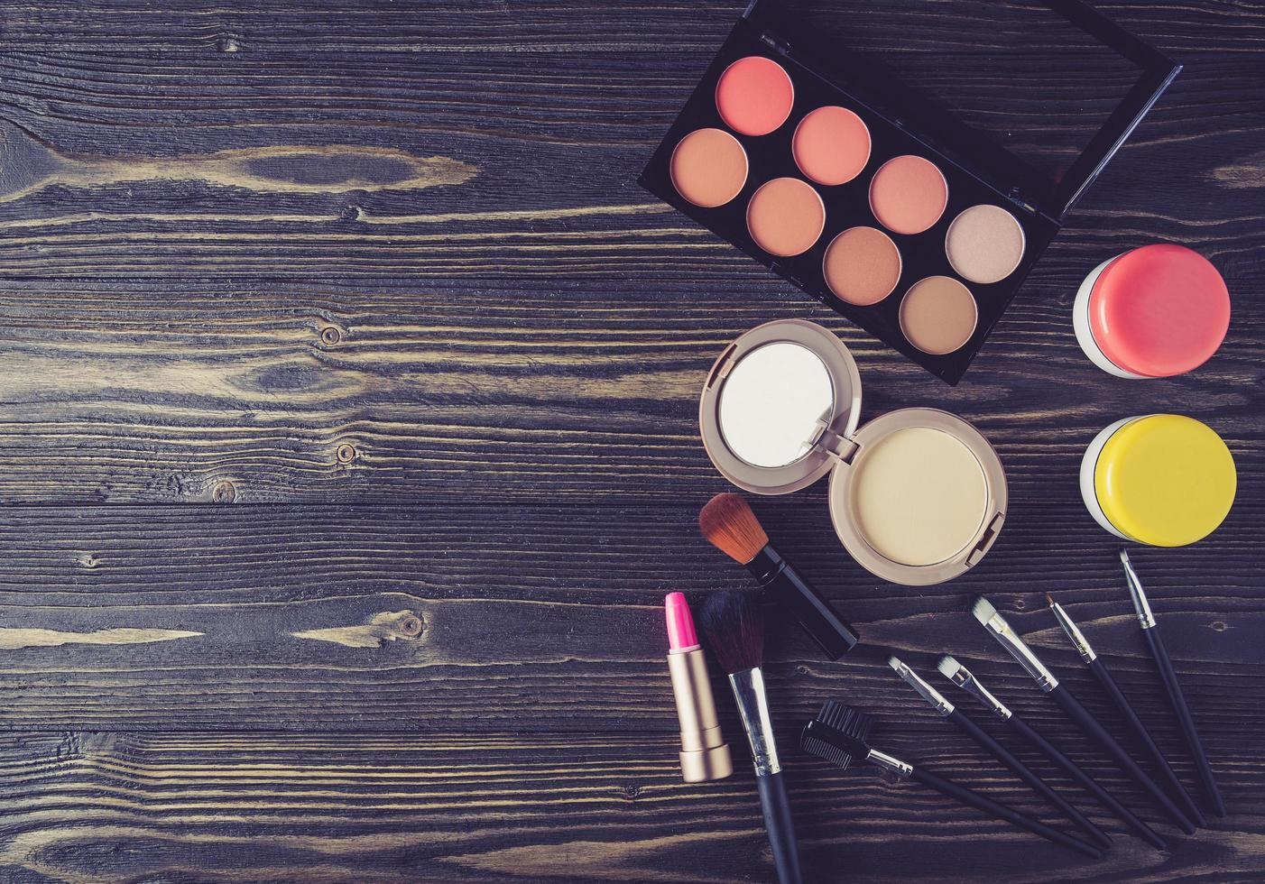 Makeup on wooden surface photo