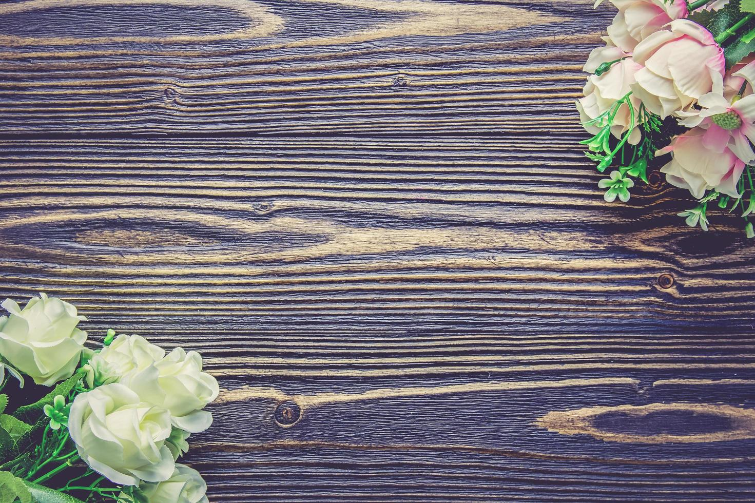 Bouquets on wooden table photo