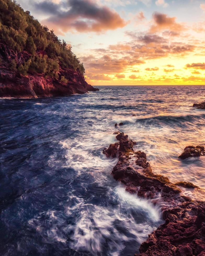 Ocean waves crashing on rocks photo