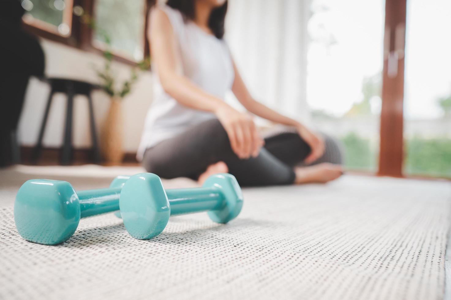 Pair of dumbbells on the living room floor photo