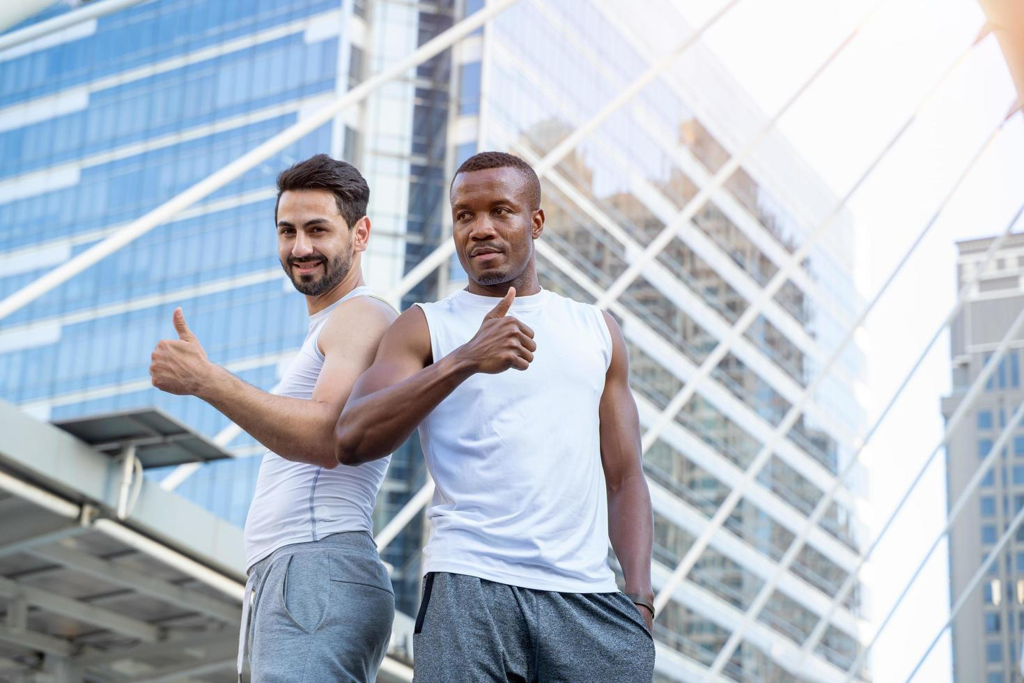 Two men in athletic clothes in city scene photo